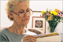 senior woman reading mail