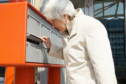 senior woman at mailbox