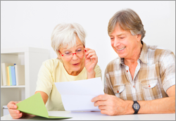 older couple reading letter